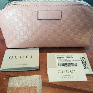 Gucci Microguccissima soft pink cosmetic case.